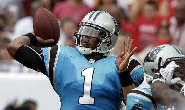 Carolina Panthers quarterback Cam Newton throws a pass during the first quarter of an NFL football game against the Tampa Bay Buccaneers, Sunday, Sept. 9, 2012, in Tampa, Fla. (AP Photo/Chris O'Meara)