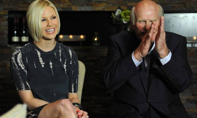 Rachel Bradshaw, daughter of former Pittsburgh Steelers quarterback Terry Bradshaw, right, is signing a record deal with Bigger Picture Group on Wednesday, April 4, 2012, in Nashville, Tenn. (AP Photo/Joe Howell)