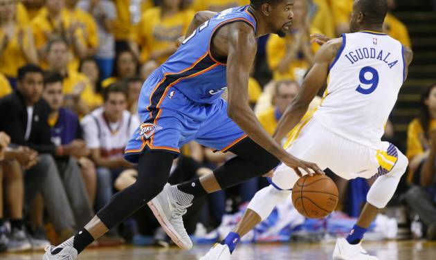 Oklahoma City\'s Kevin Durant (35) goes past Golden State\'s Andre Iguodala (9) during Game 7 of...