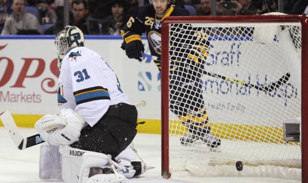 San Jose Sharks goaltender Antti Neimi (31), of Finland, is scored on by Buffalo Sabres' Cody Hodgson, not seen, as Sabres left winger Matt Moulson (26) watches during the first period of an NHL hockey game in Buffalo, N.Y., Friday, Feb. 28,  2014. (AP Photo/Gary Wiepert)