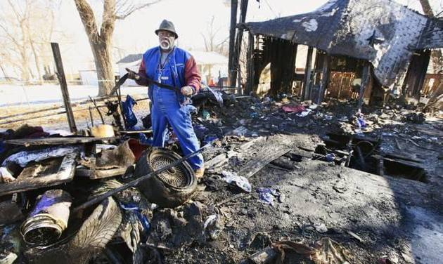 Charles Williams, Oklahoma City, searching the debris for his belongings after a fire destroyed a home he owns at 912 S Rockwood Ave. in Oklahoma City Tuesday, Mar. 4, 2014. Mr. Williams was living in another home he owns at the time of th fire. Photo by Paul B. Southerland, The Oklahoman