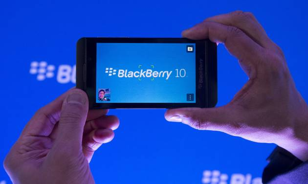 CORRECTS PHONE MODEL NAME TO Z10 INSTEAD OF 10 - Arun Kumar, a senior product manager for BlackBerry, shows off the new BlackBerry Z10 during the global launch of the new Blackberry smartphones in Toronto on Wednesday, Jan. 30, 2013. BlackBerry is promising a speedy browser, a superb typing experience and the ability to keep work and personal identities separate on the same phone, the fruit of a crucial, long-overdue makeover for the company. (AP Photo/The Canadian Press, Nathan Denette)