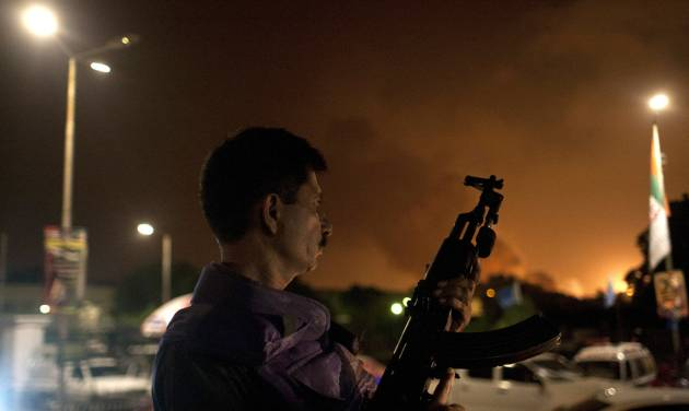 A Pakistani soldier takes position at Jinnah International Airport  where security forces are fighting with gunmen who disguised themselves as police guards and stormed a terminal used for VIPs and cargo, Sunday night, June 8, 2014, in Pakistan. The airport attack still was ongoing early Monday in Karachi, a sprawling port city on the southern coast of Pakistan, although officials said all the passengers had been evacuated.  (AP Photo/Shakil Adil)