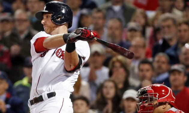 Boston Red Sox's Will Middlebrooks hits an RBI single as Cincinnati Reds catcher Brayan Pena is behind the plate in the eighth inning of a baseball game at Fenway Park in Boston, Wednesday, May 7, 2014. (AP Photo/Elise Amendola)