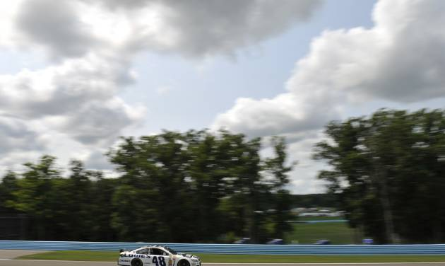 Jimmie Johnson (48) drives during a practice session for Sunday's NASCAR Sprint Cup Series auto race at Watkins Glen International, Friday, Aug. 8, 2014, in Watkins Glen N.Y.   (AP Photo/Derik Hamilton)
