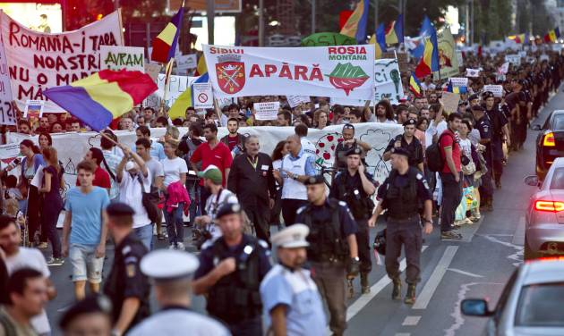 Protesters march downtown Bucharest, Romania, Sunday, Sept. 8, 2013. Thousands have protested for the seventh day running against Canadian gold mine supported by the government which would be the biggest gold mine in Europe, in the Transylvanian town of Rosia Montana, angry because it would use cyanide in the extraction process.(AP Photo/Vadim Ghirda)