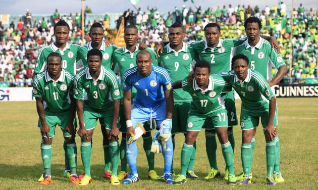 FILE - In this Nov. 16, 2013 file photo, Nigeria soccer team poses prior to start the World Cup qualifying match between Nigeria and Ethiopia at U. J. Esuene Stadium, in Calabar, Nigeria. Background from left:  Mikel John Obi, Omeruo Kenneth, Ideye Brown, Emenike Emmanuel, Godfrey Oboabona, and Ambrose Efe. Foreground from left: Victor Moses, Echieille Elderson, Enyeama Vincent, Onazi Ogenyi, and Amhed Musa. (AP Photo/Sunday Alamba, File)