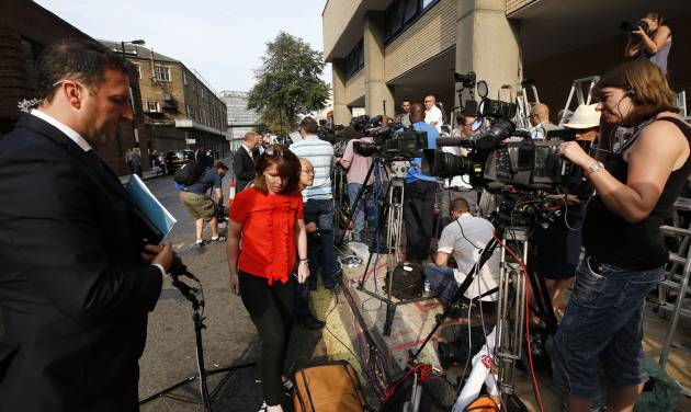 Members of the broadcast media give live reports across from St. Mary's Hospital exclusive Lindo Wing in London, Monday, July 22, 2013. Buckingham Palace officials say Prince William's wife, Kate, has been admitted to the hospital in the early stages of labour.Royal officials said that Kate traveled by car to St. Mary's Hospital in central London. Kate _ also known as the Duchess of Cambridge _ is expected to give birth in the private Lindo Wing of the hospital, where Princess Diana gave birth to William and his younger brother, Prince Harry.The baby will be third in line for the British throne _ behind Prince Charles and William _ and is anticipated eventually to become king or queen. (AP Photo/Lefteris Pitarakis)