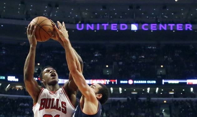 Chicago Bulls forward Jimmy Butler (21) shoots over Charlotte Bobcats guard Jeffery Taylor during the first half of an NBA basketball game, Monday, Jan. 28, 2013, in Chicago. (AP Photo/Charles Rex Arbogast)