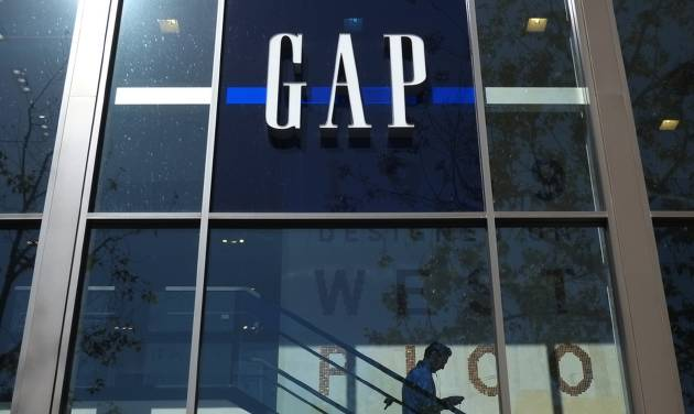 In this Tuesday, Feb. 26, 2013, photo, a shopper walks down the steps at a Gap store in Los Angeles.  Gap Inc. reported a 61 percent increase in fourth-quarter profits Thursday, Feb. 28, 2013, capping a strong year that saw the company's turnaround take hold. (AP Photo/Jae C. Hong)