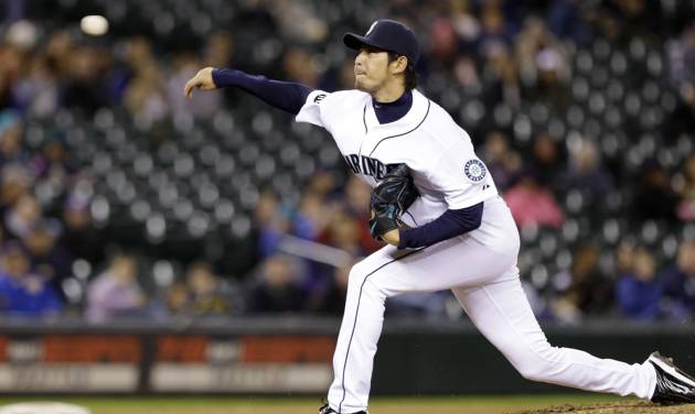 Seattle Mariners starting pitcher Hisashi Iwakuma throws against the Kansas City Royals in the eighth inning of a baseball game Wednesday, Sept. 25, 2013, in Seattle. The Mariners won 6-0. (AP Photo/Elaine Thompson)
