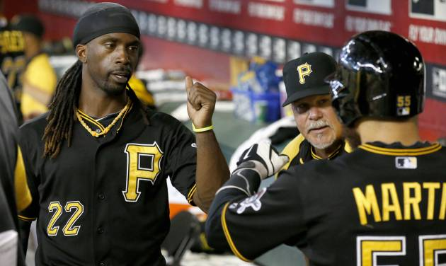 Pittsburgh Pirates' Andrew McCutchen (22) congratulates teammate Russell Martin, right, after Martin scored a run against the Arizona Diamondbacks during the second inning of a baseball game on Sunday, Aug. 3, 2014, in Phoenix. (AP Photo/Ross D. Franklin)