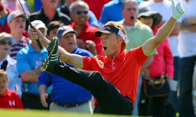 Bernhard Langer reacts after chipping in for a birdie from off the 10th green during the final round of the Greater Gwinnett Championship golf tournament, Sunday, April 21, 2013, in Duluth, Ga. (AP Photo/Atlanta Journal-Constitution, Curtis Compton)  MARIETTA DAILY OUT; GWINNETT DAILY POST OUT; LOCAL TV OUT; WXIA-TV OUT; WGCL-TV OUT