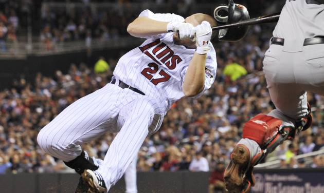 Minnesota Twins' Chris Parmelee goes down after he was hit in the helmet by a pitch from Boston Red Sox pitcher Justin Thomas in the sixth inning of a baseball game Wednesday, April 25, 2012, in Minneapolis. Parmelee left the game. (AP Photo/Jim Mone)