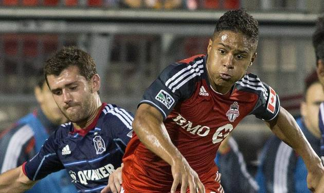Toronto FC's Quincy Amarikwa tries to cut between Chicago Fire's Gonzalo Segares, left, during the first half of an MLS soccer game in Toronto on Wednesday, Sept. 12, 2012. (AP Photo/The Canadian Press, Chris Young)