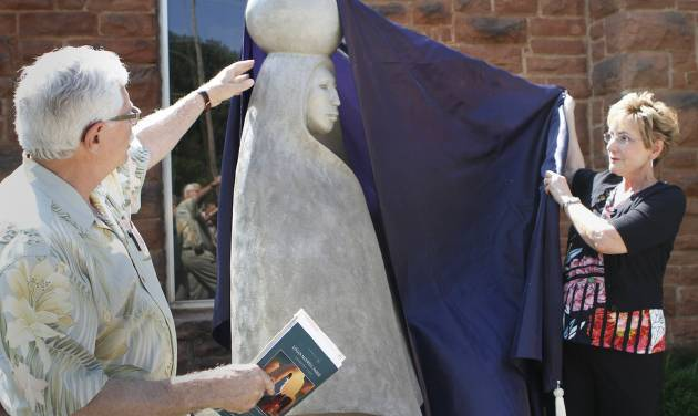 "Above:  Former Edmond Mayor Randel Shadid and Beverly Chaumont, Edmond Visual Arts Commission chairwoman, unveil ""Water Bearer II"" during the dedication Tuesday at the Edmond Historical Society and Museum.  David McDaniel - The Oklahoman"