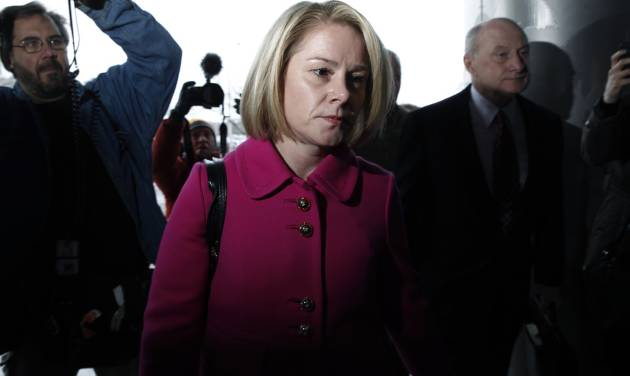 New Jersey Gov. Chris Christie's former Deputy Chief of Staff Bridget Kelly, and her attorney Michael Critchley, right, arrive at court for a hearing Tuesday, March 11, 2014, in Trenton, N.J.  Attorneys for Kelly and two-time campaign manager Bill Stepien are in court to try to persuade a judge not to force them to turn over text messages and other private communications to New Jersey legislators investigating the political payback scandal ensnaring Christie's administration. (AP Photo/Mel Evans)