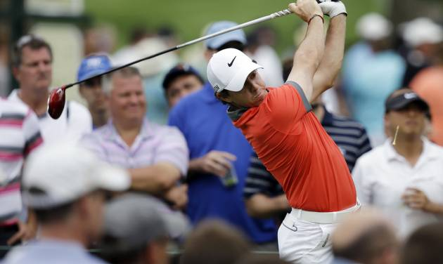 Rory McIlroy, of Northern Ireland, tees off on the 15th hole during the first round of the Memorial golf tournament Thursday, May 29, 2014, in Dublin, Ohio. (AP Photo/Darron Cummings)