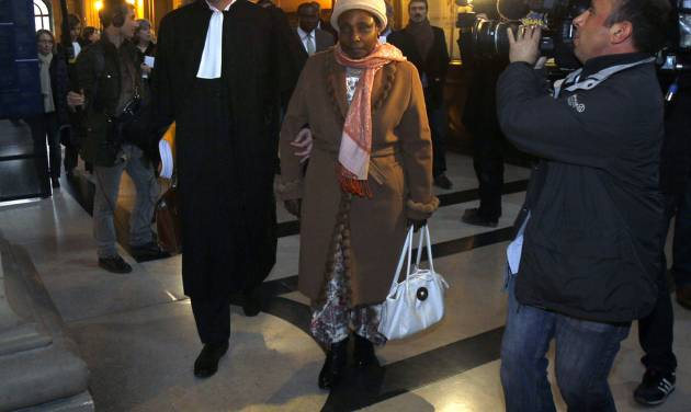Agathe Habyarimana, center, the widow of former President of Rwanda Juvenal Habyarimana, arrives with her lawyer Philippe Meillac, left, at a Paris court house, Tuesday, Jan. 10, 2012. A French investigator is releasing the results of his investigation Tuesday into the downing of the plane of President Juvenal Habyarimana, which helped spark Rwanda's 1994 genocide. (AP Photo/Remy de la Mauviniere)