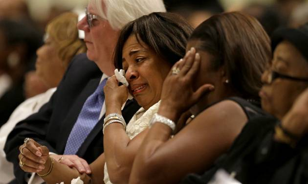 "Donna Kelly Pratte, mother of Chris Kelly of the rap duo Kris Kross, wipes a tear during the funeral for her son, Thursday, May 9, 2013, in Atlanta. The 34-year-old Kelly was found dead May 1 of a suspected drug overdose. Kriss Kross was introduced to the music world in 1992 by music producer and rapper Jermaine Dupri after he discovered the pair at a mall in southwest Atlanta. Kelly performed alongside Chris Smith, who known as ""Daddy Mac.""  (AP Photo/David Goldman)"