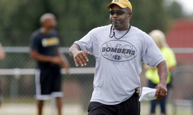 HIGH SCHOOL FOOTBALL: Midwest City coach Darrell Hall blows a whistle during football practice at Midwest City High School on Tuesday, August 14, 2013. Photo by Bryan Terry, The Oklahoman