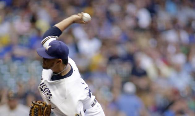 Milwaukee Brewers pitcher Yovani Gallardo pitches to the Pittsburgh Pirates during the first inning of a baseball game Friday, Aug. 22, 2014, in Milwaukee. (AP Photo/Darren Hauck)