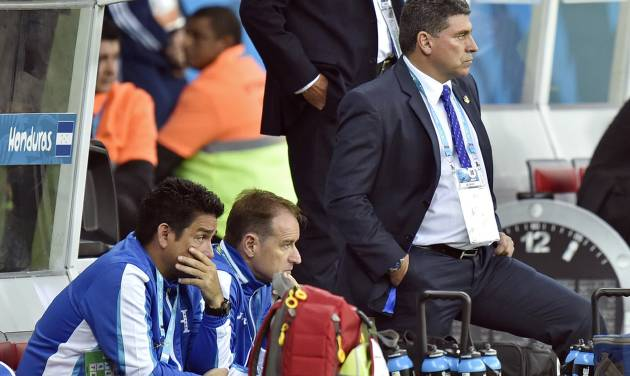 Honduras' head coach Luis Suarez, right, stands by his team's bench during the group E World Cup soccer match between France and Honduras at the Estadio Beira-Rio in Porto Alegre, Brazil, Sunday, June 15, 2014. France defeated Honduras 3-0.  (AP Photo/Martin Meissner)
