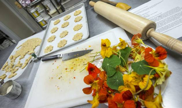 """Greenport chocolatier Miche Bacher, author of """"Cooking with Flowers,"""" uses all natural ingredients in her chocolates, cookies and cakes in the Greenport studio. (Randee Daddona/Newsday/MCT)"""