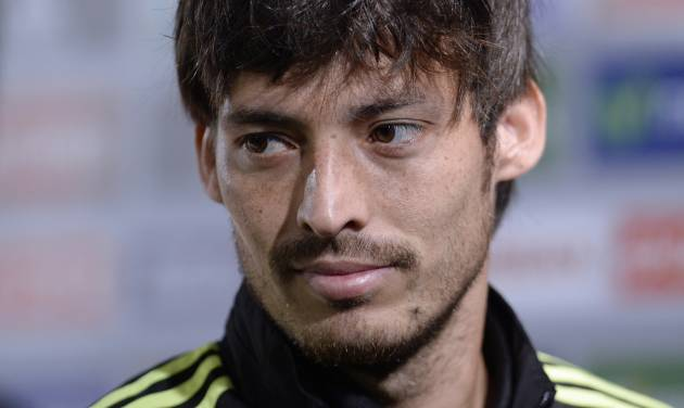 Spain's David Silva looks on after a press conference at the Atletico Paranaense training center in Curitiba, Brazil, Saturday, June 21, 2014. Spain will play in group B of the Brazil 2014 World Cup. (AP Photo/Manu Fernandez)