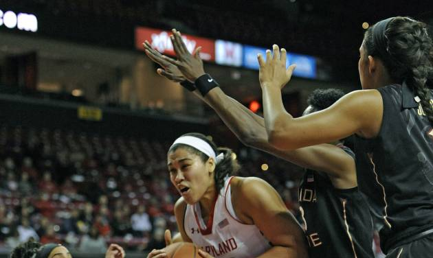 Maryland's Brionna Jones, center, drives to the basket as Florida State's Cheetah Delgado, left, Natasha Howard, center right, and Morgan Jones defend in the first half of an NCAA college basketball game Thursday, Feb. 20, 2014, in College Park, Md. (AP Photo/Gail Burton)