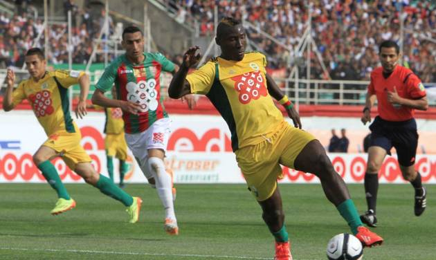 In this photo dated May 2, 2014, JS Kabylie striker Albert Ebosse of Cameroon controls the ball during the final of the Algerian soccer Cup in Blida near the Algerian capital, Algiers. Ebosse died after being hit in the head by an object thrown from the crowd at a top-flight league game in Algeria last August 23, 2014. Angry fans in Algeria pelted their own soccer team with rocks after they lost a game, killing the star player in the latest incident of fan violence in this North African country. Like much of the rest of the continent, Algeria's restless youth are passionate about soccer but with little other outlet for their daily frustration, violence haunts the games. (AP Photo)
