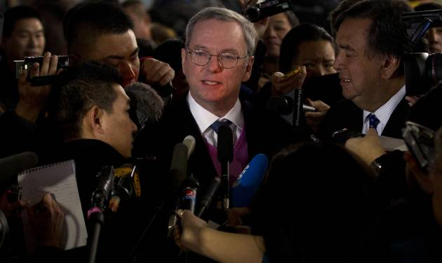 Google executive chairman Eric Schmidt, center, and former New Mexico Gov. Bill Richards, right, brief journalists after they arrived at Beijing Capital International Airport from Pyongyang, in Beijing Thursday, Jan. 10, 2013. Schmidt is urging North Korea to shed its self-imposed isolation and allow its citizens to use the Internet or risk being left behind economically. (AP Photo/Alexander F. Yuan)