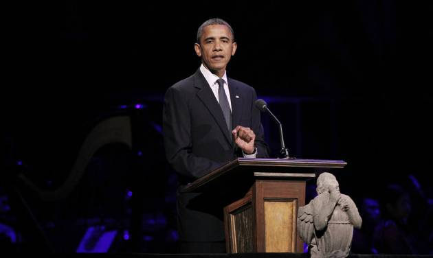 "President Barack Obama speaks at ""A Concert for Hope"" at the Kennedy Center in Washington, Sunday, Sept. 11, 2011, on the 10th anniversary of the Sept. 11 terrorist attacks. In front of the podium is a limestone angel which broke off the National Cathedral during last month's East coast earthquake. (AP Photo/Charles Dharapak)"