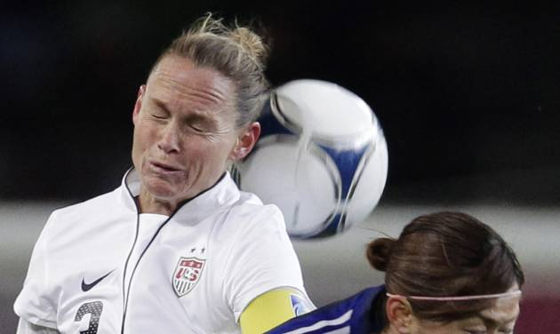 Christie Rampone of the United States, left, fights for the ball with Japan's Nahomi Kawasumi during their women's friendly soccer match in Sendai, Japan, Sunday, April 1, 2012. (AP Photo/Shizuo Kambayashi)