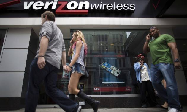 "Pedestrians pass a Verizon Wireless store on Canal Street, Thursday, June 6, 2013, in New York. The Obama administration on Thursday, June 6, 2013, defended the government's need to collect telephone records of American citizens, calling such information ""a critical tool in protecting the nation from terrorist threats."" Britain's Guardian newspaper reported that the NSA has been collecting the telephone records of millions of Verizon customers under a top secret court order. (AP Photo/John Minchillo)"