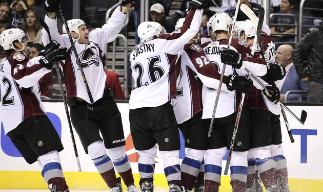 Members of the Colorado Avalanche celebrate a game-winning goal by Jamie McGinn in overtime of an NHL hockey game against the Los Angeles Kings on Saturday, Nov. 23, 2013, in Los Angeles. The Avalanche won 1-0 in overtime. (AP Photo/Jae C. Hong)