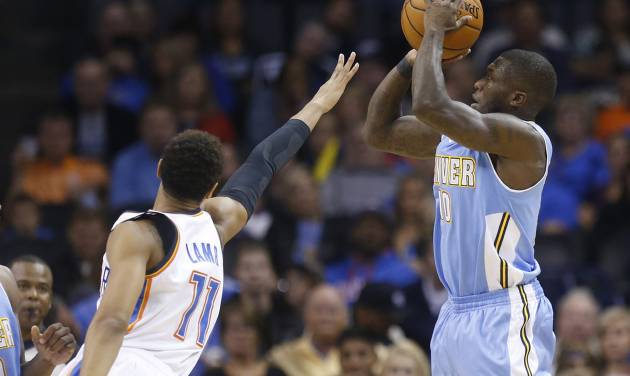 Denver Nuggets guard Nate Robinson (10) shoots over Oklahoma City Thunder guard Jeremy Lamb (11) in the first quarter of a pre-season NBA basketball game in Oklahoma City, Tuesday, Oct. 15, 2013. Oklahoma City won 109-81. (AP Photo/Sue Ogrocki)