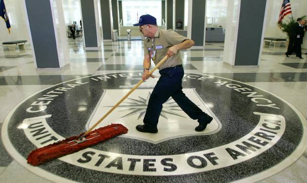 FILE - A workman quickly slides a dustmop over the floor at the Central Intelligence Agency headquarters in Langley, Va., near Washington, in this March 3, 2005 file photo. About a dozen former CIA officials named in a classified Senate report on decade-old agency interrogation practices were notified in recent days that they would be able to review parts of the document in a secure room in suburban Washington after signing a secrecy agreement. Then, on Friday, July 25, 2014 many were told they would not be able to see it, after all. (AP Photo/J. Scott Applewhite, File)