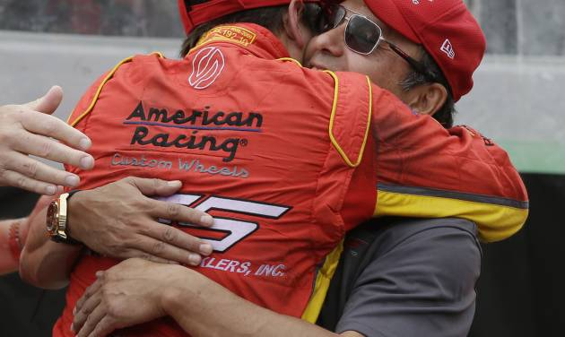 Sebastian Saavedra, of Colombia, hugs Wilson Saavedra after winning the pole for the inaugural Grand Prix of Indianapolis IndyCar auto race at the Indianapolis Motor Speedway in Indianapolis, Friday, May 9, 2014. (AP Photo/Darron Cummings)