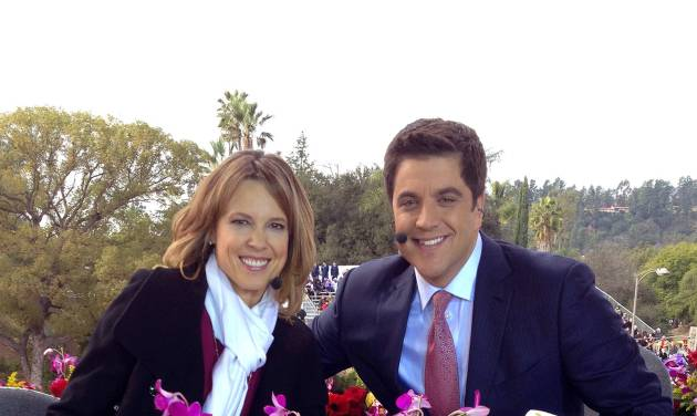 In this photo provided by Hannah Storm, ESPN anchor Hannah Storm, left, poses for a photo with co-host Josh Elliott, anchor for ABC's Good Morning America, on the parade grounds of the Rose Parade on Tuesday, Jan. 1, 2013, in Pasadena, Calif. Storm hosted the Rose Parade telecast Tuesday in her first on-air appearance since sustaining first- and second-degree burns to her face, hands, chest and neck in a propane gas grill accident Dec. 11. (AP Photo/Courtesy Hannah Storm)