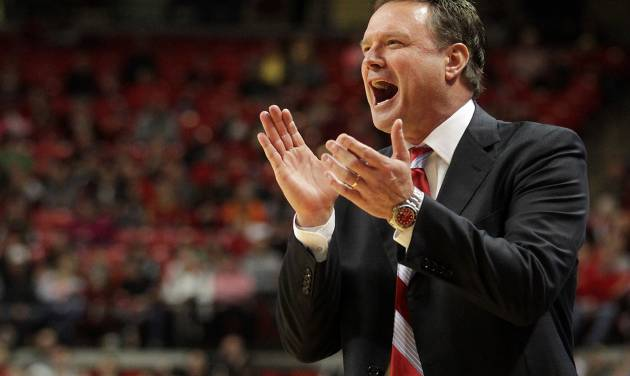Kansas' Bill Self cheers as his team scores against Texas Tech during an NCAA college basketball game in Lubbock, Texas, Saturday, Jan. 12, 2013. (AP Photo/Lubbock Avalanche-Journal,Stephen Spillman) ORG XMIT: TXLUB105