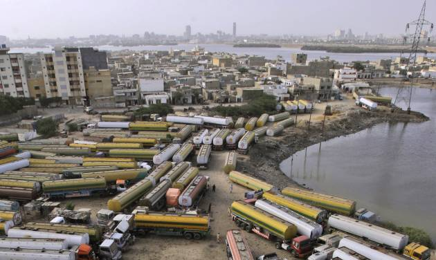 Oil tankers, which were used to transport NATO fuel supplies to Afghanistan, are parked at a compound in Karachi, Pakistan, Tuesday, May 15, 2012. NATO on Tuesday invited Pakistani President Asif Ali Zardari to the alliance's summit in Chicago, after signs that the country could be moving to reopen its Afghan border to NATO military supplies. (AP Photo/Shakil Adil)