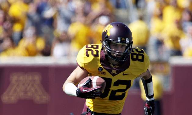 Minnesota wide receiver A.J. Barker (82) heads to the end zone on a 53 yard touchdown catch and run during the first half of an NCAA football game, Saturday, Sept. 15, 2012, in Minneapolis. Minnesota won 28-23. Barker finished with 101 yards and three touchdowns. (AP Photo/Paul Battaglia)