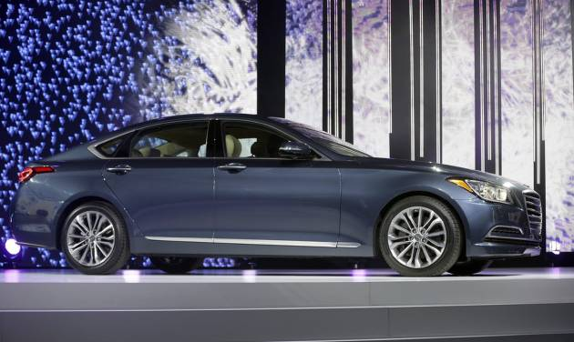 The Hyundai Genesis is unveiled at the North American International Auto Show in Detroit, Monday, Jan. 13, 2014. (AP Photo/Carlos Osorio)