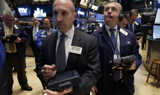 Trader James Denaro, center, works on the floor of the New York Stock Exchange, Monday, April 7, 2014.  Stocks are starting out the week the same way they ended the last one, down. (AP Photo/Richard Drew)