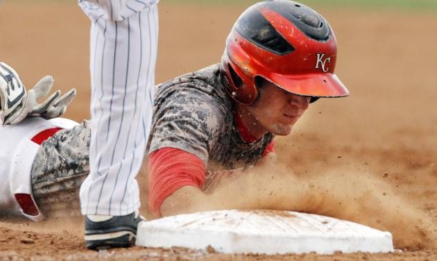 Kansas base runner Logan Blaine (6) slides head first into first base during a Class 3A baseball state game between Jones and Kansas at Edmond Memorial High School, Thursday, May 15, 2014, in Edmond. Photo by KT King, For The Oklahoman