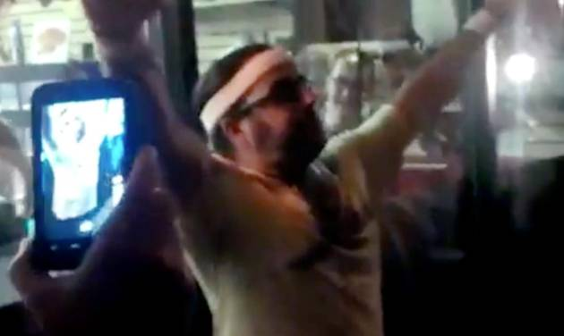 CORRECTS SOURCE TO SARAH BERNARD - In this frame grab made from video on Friday, Oct. 5, 2012, and provided by Sarah Bernard, Edward Archbold celebrates winning a roach-eating contest at Ben Siegel Reptile Store in Deerfield Beach, Fla. Archbold, 32, died shortly after downing dozens of the live bugs as well as worms, authorities said Monday, Oct. 8. Authorities were waiting for results of an autopsy to determine a cause of death. (AP Photo/Courtesy Sarah Bernard)