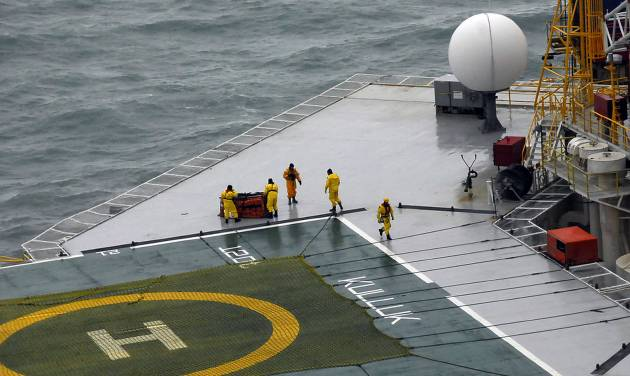A salvage team moves an emergency towing system across the deck of petroleum drilling ship Kulluk in this photo made Wednesday, Jan. 2, 2013, and provided by the U.S. Coast Guard. There's no indication of a fuel leak from Kulluk, the Coast Guard said Wednesday night, Jan. 2, 2013, of a maritime accident that has refueled debate over oil exploration in the U.S. Arctic Ocean. (AP Photo/U.S. Coast Guard)