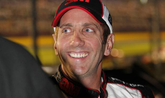 Greg Biffle smiles after qualifying for Saturday's NASCAR Bank of America 500 Sprint Cup series auto race in Concord, N.C., Thursday, Oct. 11, 2012. Biffle won the pole position for the race. (AP Photo/Terry Renna)