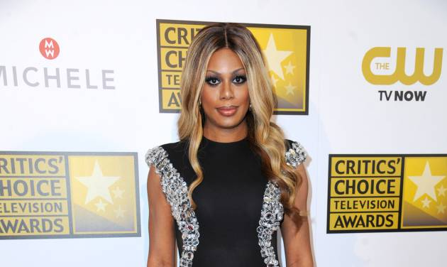 """FILE - In this June 19, 2014, file photo, Laverne Cox arrives at the Critics' Choice Television Awards at the Beverly Hilton Hotel on Thursday, June 19, 2014, in Beverly Hills, Calif. President Barack Obama during his first year in office became the first chief executive to say """"transgender"""" in a speech, the first to name transgender political appointees and the first to prohibit job bias against transgender government workers. He also signed hate crime legislation that represented the first federal civil rights protections for transgender people in U.S. history. (Photo by Richard Shotwell/Invision/AP, File)"""